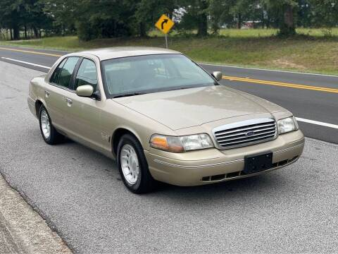 1999 Ford Crown Victoria for sale at Two Brothers Auto Sales in Loganville GA