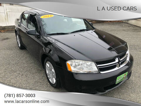 2012 Dodge Avenger for sale at L A Used Cars in Abington MA