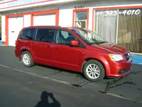 2014 Dodge Grand Caravan for sale at Cedar Auto Sales in Lansing MI