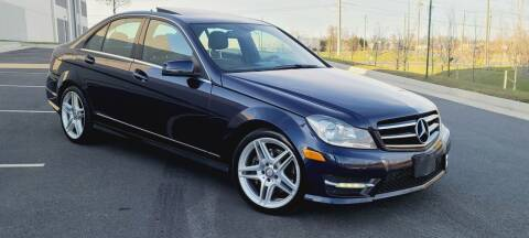 2014 Mercedes-Benz C-Class for sale at BOOST MOTORS LLC in Sterling VA