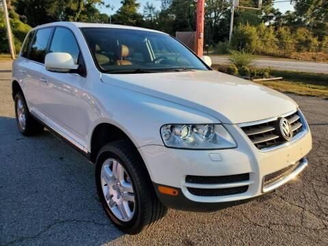2006 Volkswagen Touareg for sale at GEORGIA AUTO DEALER, LLC in Buford GA
