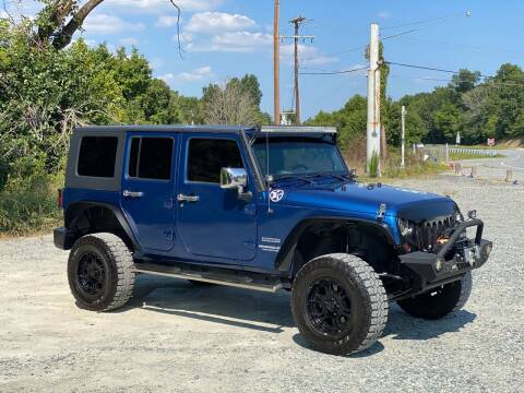 2010 Jeep Wrangler Unlimited for sale at Charlie's Used Cars in Thomasville NC