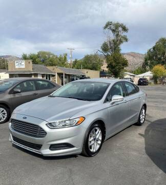 2013 Ford Fusion for sale at Smart Buy Auto Sales in Ogden UT