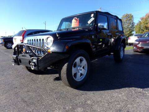 2012 Jeep Wrangler Unlimited for sale at Pool Auto Sales Inc in Spencerport NY