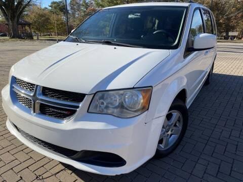 2012 Dodge Grand Caravan for sale at JES Auto Sales LLC in Fairburn GA