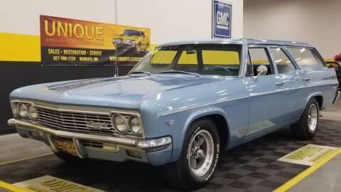1966 Chevrolet Bel Air for sale at UNIQUE SPECIALTY & CLASSICS in Mankato MN