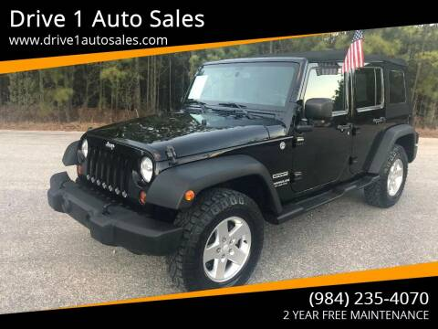 2013 Jeep Wrangler Unlimited for sale at Drive 1 Auto Sales in Wake Forest NC
