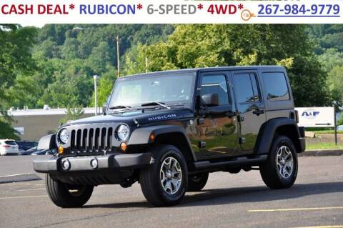 2013 Jeep Wrangler Unlimited for sale at T CAR CARE INC in Philadelphia PA