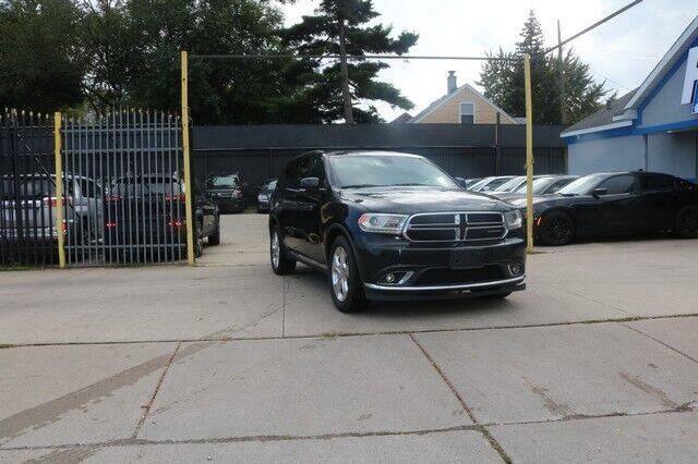 2014 Dodge Durango for sale at F & M AUTO SALES in Detroit MI
