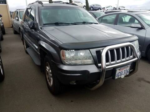 2004 Jeep Grand Cherokee for sale at MCHENRY AUTO SALES in Modesto CA