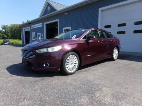 2013 Ford Fusion Hybrid for sale at Pool Auto Sales Inc in Spencerport NY