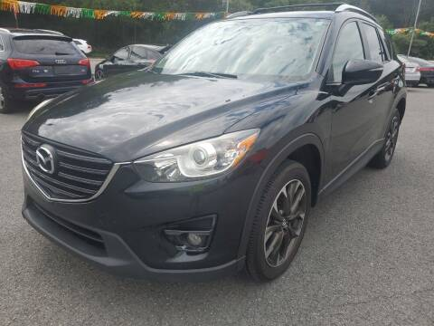 2016 Mazda CX-5 for sale at Mulligan's Auto Exchange LLC in Paxinos PA