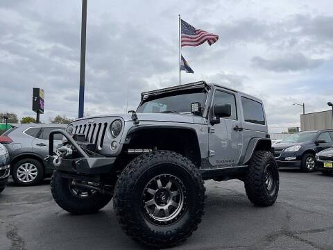 2014 Jeep Wrangler for sale at New Wave Auto Brokers & Sales in Denver CO