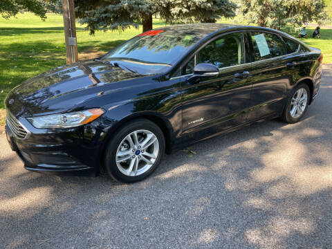 2018 Ford Fusion Hybrid for sale at BELOW BOOK AUTO SALES in Idaho Falls ID