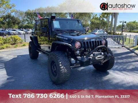 2016 Jeep Wrangler Unlimited for sale at AUTOSHOW SALES & SERVICE in Plantation FL