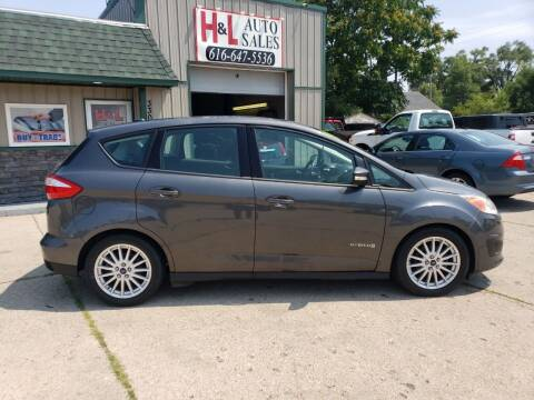 2015 Ford C-MAX Hybrid for sale at H & L AUTO SALES LLC in Wyoming MI