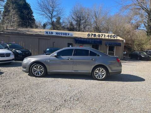 2014 Ford Taurus for sale at Mad Motors LLC in Gainesville GA