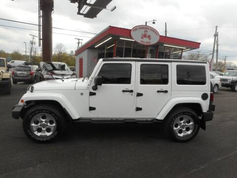 2014 Jeep Wrangler Unlimited for sale at The Carriage Company in Lancaster OH