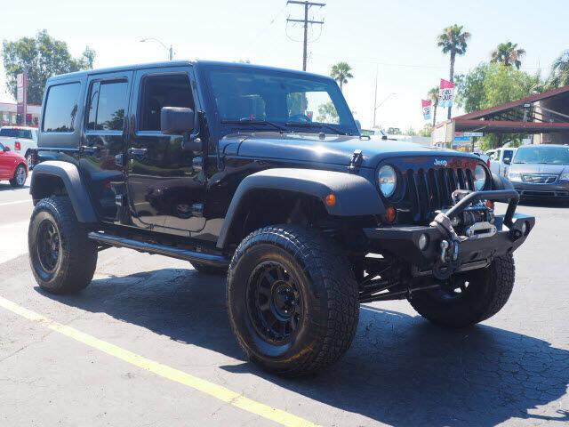 2012 Jeep Wrangler Unlimited for sale at Corona Auto Wholesale in Corona CA