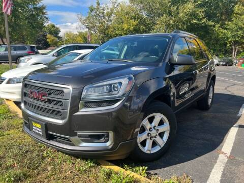 2014 GMC Acadia for sale at Chinos Auto Sales in Crystal MN