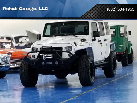 2018 Jeep Wrangler Unlimited for sale at Rehab Garage, LLC in Tomball TX