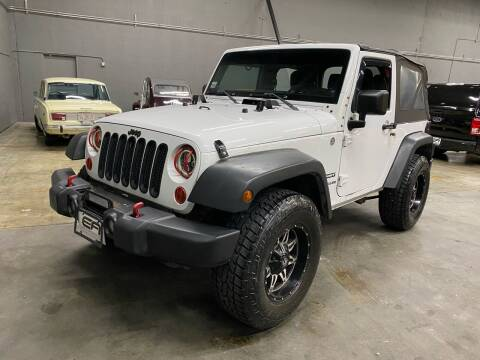 2012 Jeep Wrangler for sale at EA Motorgroup in Austin TX