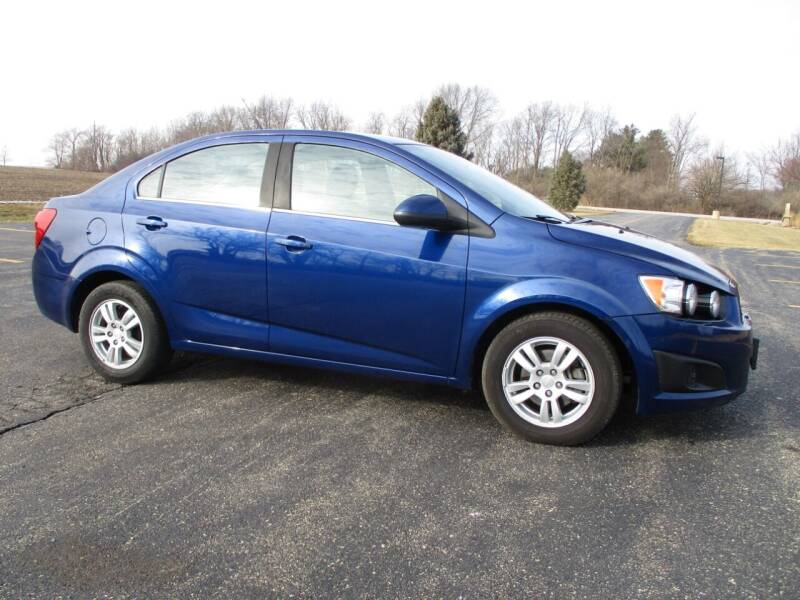 2013 Chevrolet Sonic for sale at Crossroads Used Cars Inc. in Tremont IL
