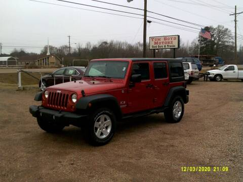 2009 Jeep Wrangler Unlimited for sale at Tom Boyd Motors in Texarkana TX