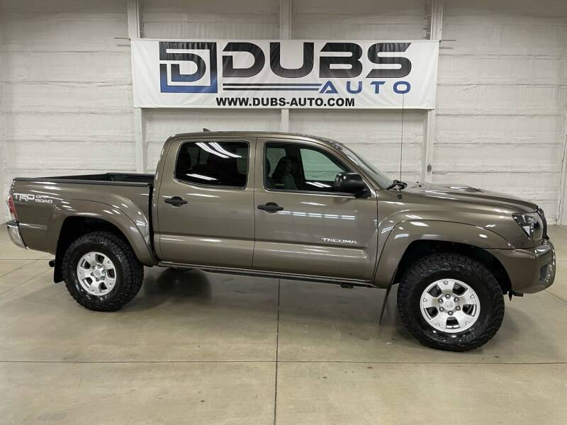 2014 Toyota Tacoma for sale at DUBS AUTO LLC in Clearfield UT