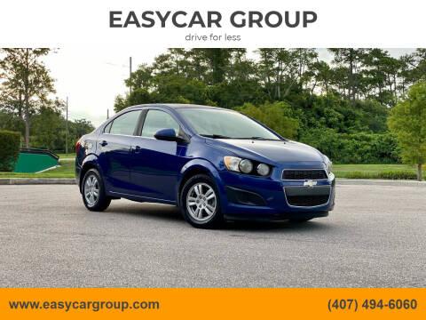 2014 Chevrolet Sonic for sale at EASYCAR GROUP in Orlando FL
