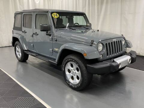 2014 Jeep Wrangler Unlimited for sale at Monster Motors in Michigan Center MI