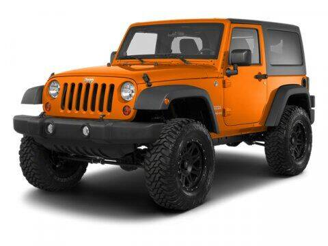 2013 Jeep Wrangler for sale at DAVID McDAVID HONDA OF IRVING in Irving TX