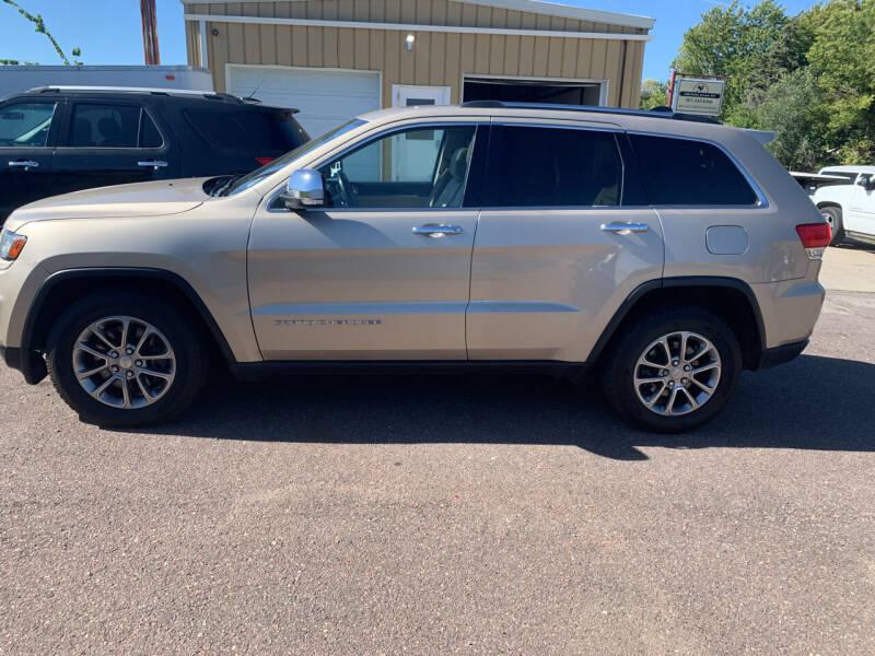 2014 Jeep Grand Cherokee for sale at Los Arreglados Auto Sales in Worthington MN