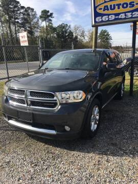 2011 Dodge Durango for sale at MOORE'S AUTOS LLC in Florence SC
