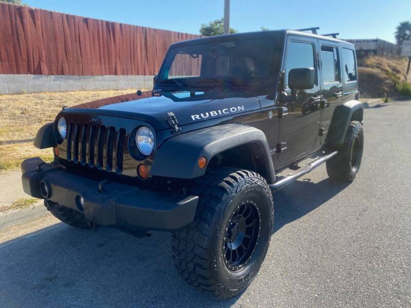 2013 Jeep Wrangler Unlimited for sale at Elite Car Center in Spring Valley CA