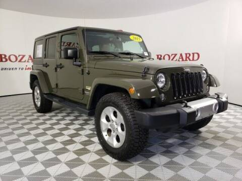 2015 Jeep Wrangler Unlimited for sale at BOZARD FORD in Saint Augustine FL