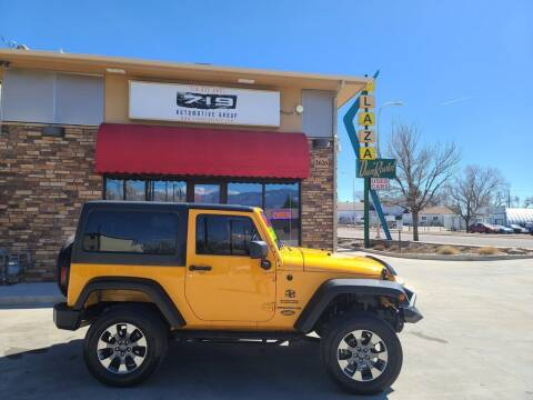 2013 Jeep Wrangler for sale at 719 Automotive Group in Colorado Springs CO
