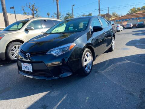 2014 Toyota Corolla for sale at MIKE AHWAZI in Santa Ana CA