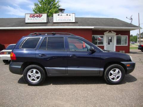 2004 Hyundai Santa Fe for sale at G and G AUTO SALES in Merrill WI