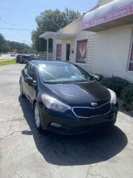 2014 Kia Forte for sale at SUN AUTOMOTIVE in Greensboro NC
