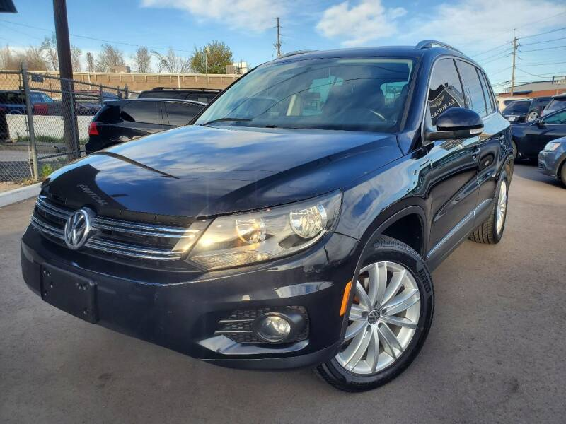 2014 Volkswagen Tiguan for sale at LA Motors LLC in Denver CO