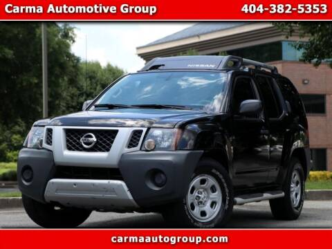 2013 Nissan Xterra for sale at Carma Auto Group in Duluth GA