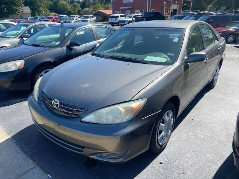 2004 Toyota Camry for sale at Sartins Auto Sales in Dyersburg TN