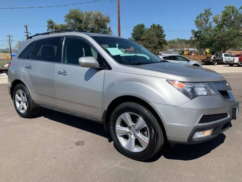 2010 Acura MDX for sale at BERKENKOTTER MOTORS in Brighton CO