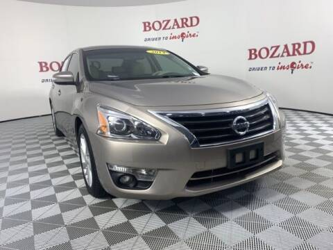 2014 Nissan Altima for sale at BOZARD FORD in Saint Augustine FL