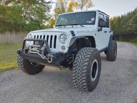 2014 Jeep Wrangler Unlimited for sale at The Car Shed in Burleson TX
