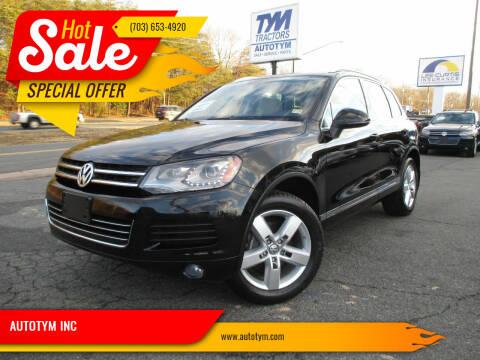 2012 Volkswagen Touareg for sale at AUTOTYM INC in Fredericksburg VA