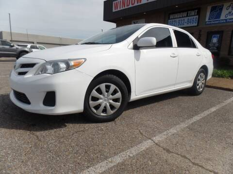 2013 Toyota Corolla for sale at Flywheel Motors, llc. in Olive Branch MS