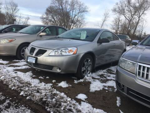2006 Pontiac G6 for sale at BARNES AUTO SALES in Mandan ND