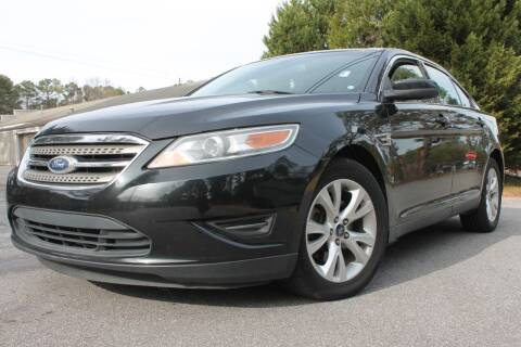 2011 Ford Taurus for sale at CAR STOP INC in Duluth GA